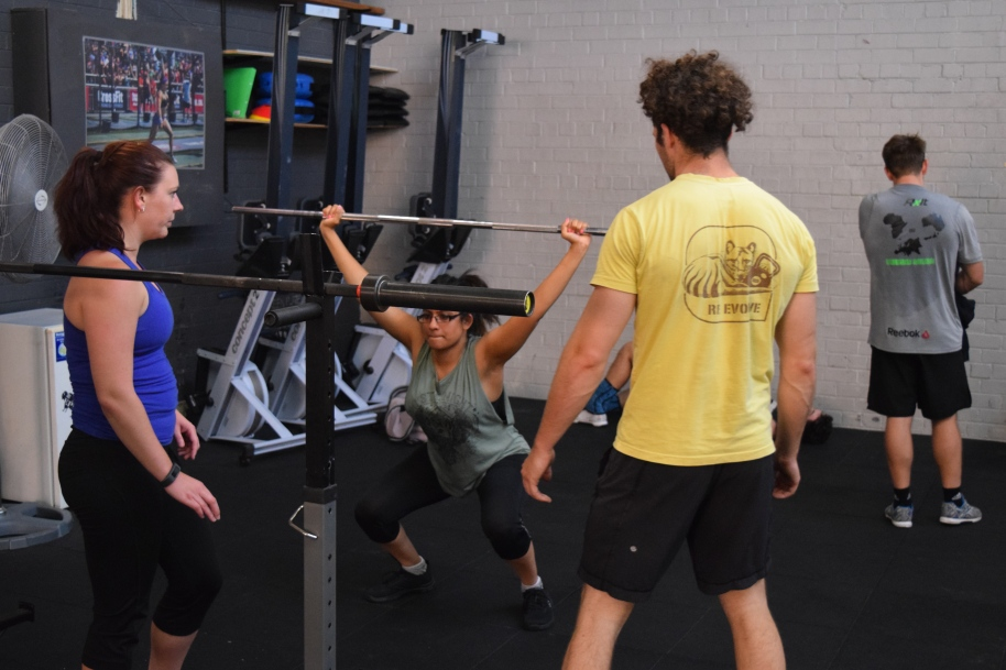 Hoff watches over Shalini's Overhead Squat form