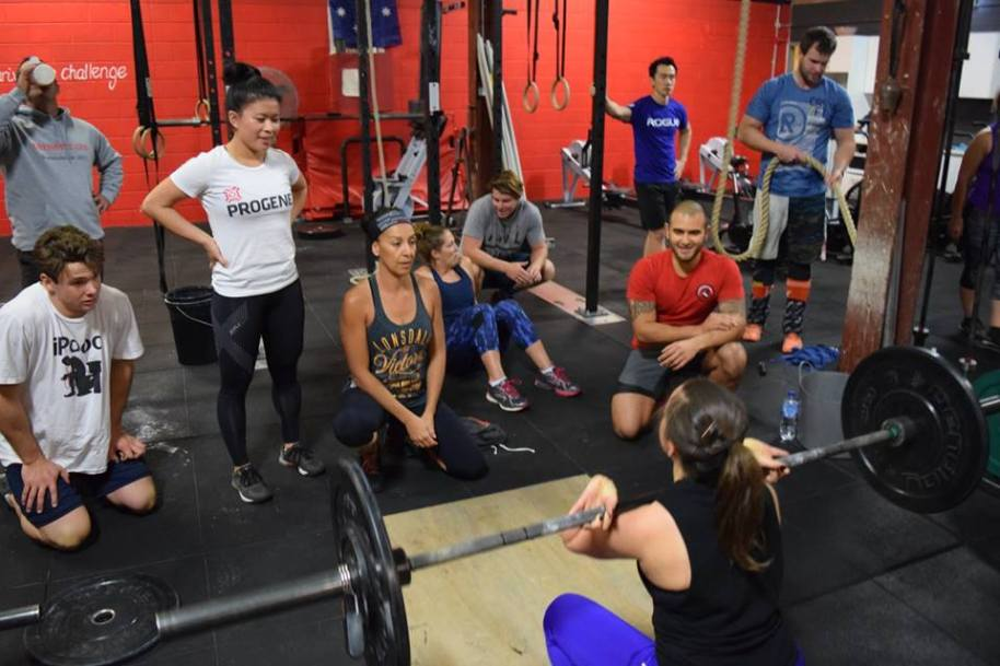 The onlookers at Friday Night Lights give Netti some support to get through her 30 Front Squats