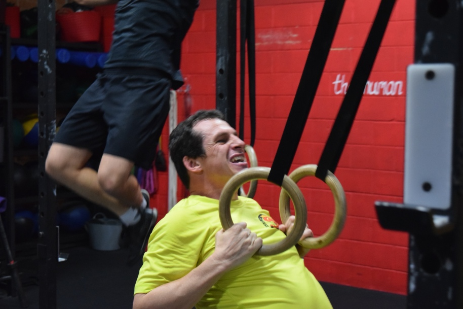 Phil has been nursing a hip injury which has restricted certain leg movements, but that hasn't stopped him from coming in and working on other movements. If you have an injury, let the Coach knowand we will change the workout for you if needed so that your injury is not affected and you can still get gains in other areas.